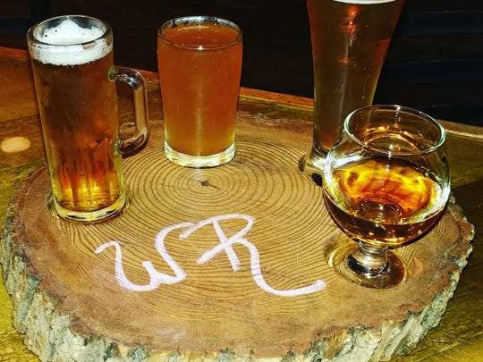 Whiskey Roads in Little Ferry offers beer flights served on a hand-carved wood tray.