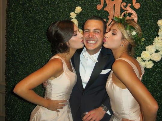 A kiss for the groom his sisters: Lauren Daniel, groom