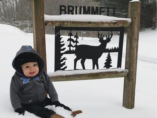 Easton Brummett, ten months, enjoys his first snow.
