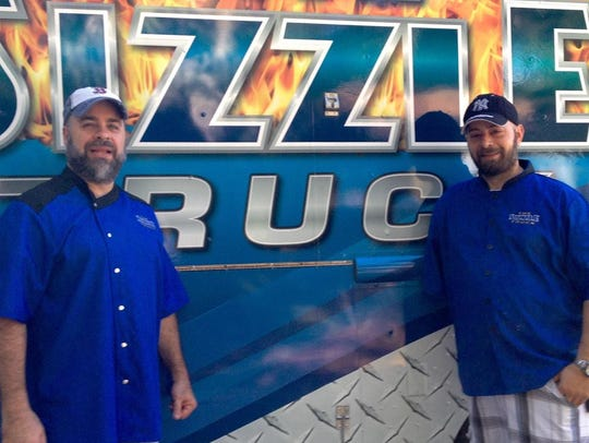 The Sizzle truck, with owners Chef Z, left, and Anthony Badalamante.