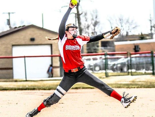 Port Huron graduate Madeline Trombly pitches during