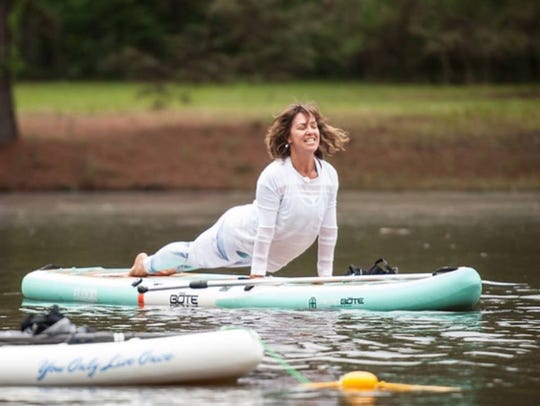 Sarah Sledge teaches paddleboard yoga at the YMCA Northwest