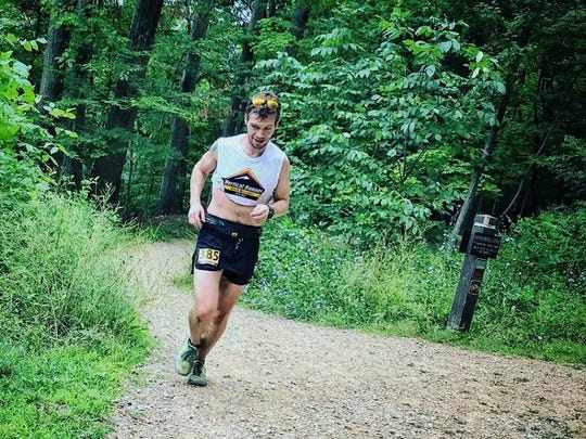 Shaun Pope, owner of Vertical Runner Black Mountain, makes his way along the trails in his native Northeastern Ohio as he finishes second in the Burning River Endurance Run 100-mile race on July 28.