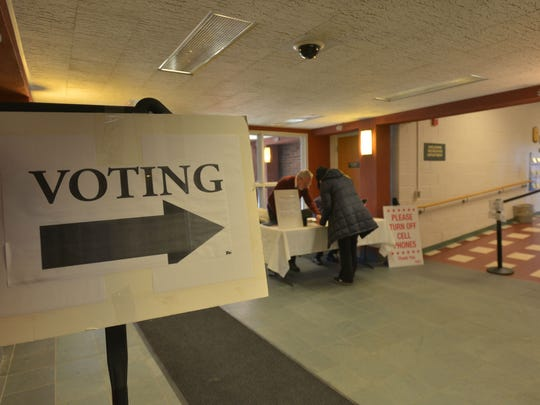 A sign in the Shelburne Municipal Office points toward the town's polling station in the gym on Tuesday, March 1, 2016.