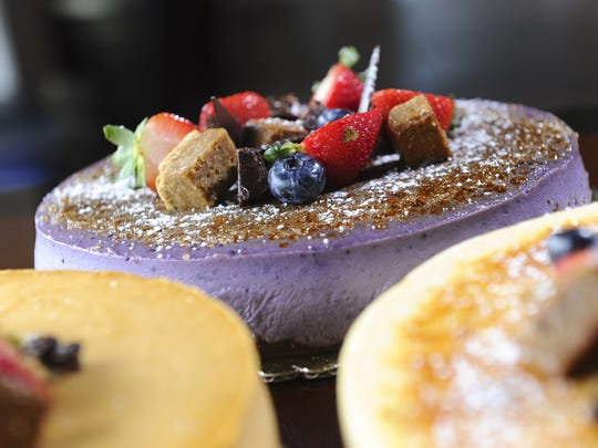 A taro cheesecake, topped with chocolate, fresh fruit pieces, along with brownie and blondie cubes, is seen after being prepared at the Proa Restaurant in Hagatna on Friday, Sept. 11.