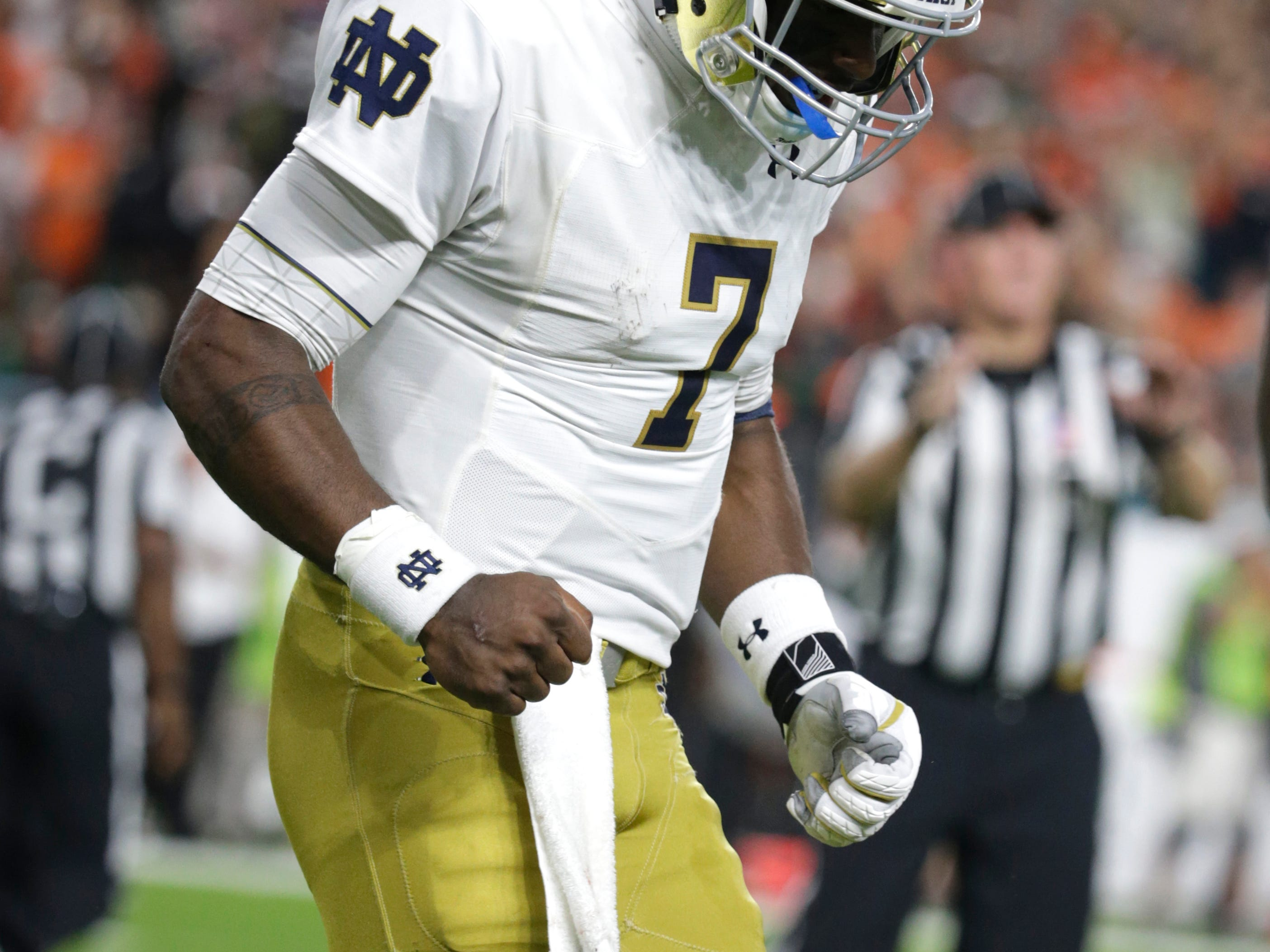 Notre Dame quarterback Brandon Wimbush (7) walks off the field after throwing an interception during the first half of an NCAA college football game against Miami, Saturday, Nov. 11, 2017, in Miami Gardens, Fla. (AP Photo/Lynne Sladky)