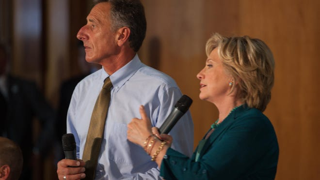 Vermont Gov. Peter Shumlin appears with presidential candidate Hillary Clinton in Laconia, N.H., for a roundtable discussion on substance abuse in 2015. Shumlin is one of three people who will cast Vermont's Electoral College votes Monday.