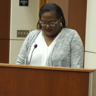 Trustee Sommer Foster reads a resolution stating that