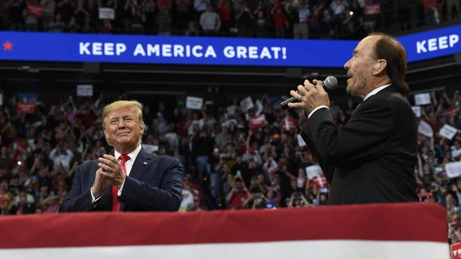 """President Donald Trump, left, is seen with singer Lee Greenwood during a campaign event in Lexington, Ky., Monday, Nov. 4, 2019. Greenwood's """"God Bless the U.S.A."""" hit No. 1 on the Billboard charts this week after 36 years on the airwaves."""