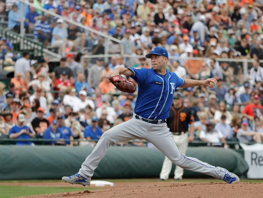 Kansas City Royals' Danny Duffy throws during the first inning of a spring training baseball game against the San Francisco Giants, Sunday, March 5, 2017, in Scottsdale, Ariz. (AP Photo/Darron Cummings)
