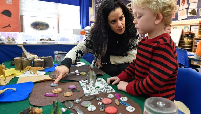 Classroom teacher Nicole Cardinale helps a student build a jungle at Appoquinimink Preschool Center in Middletown. Rep. Kim Williams says beefing up pre-K programs like this one have contributed to a gap in special education funding in later grades.