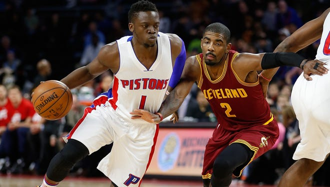 Pistons guard Reggie Jackson drives around Cavaliers guard Kyrie Irving during the first half Friday at the Palace.