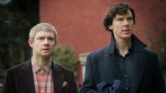 "Benedict Cumberbatch as Sherlock Holmes, right,  and Martin Freeman as John Watson star in the BBC series ""Sherlock."""