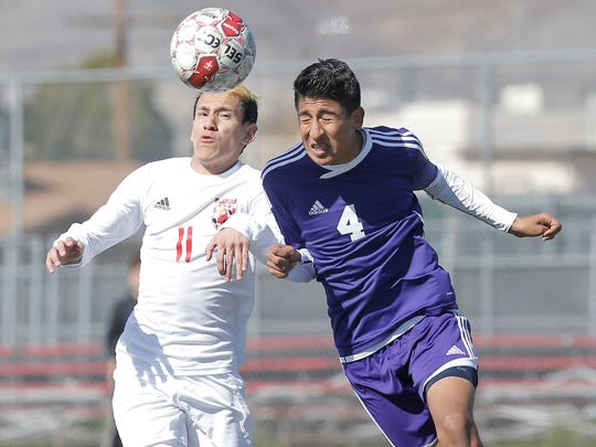 Luis Perez, right, of Burges beats Jefferson's Edwin Perez to a header during their game Saturday at Jefferson High School.