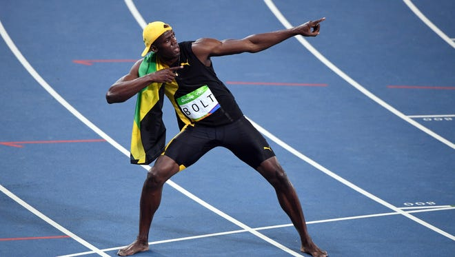 Aug. 14, 2016; Rio de Janeiro;  Usain Bolt celebrates after winning the men's 100-meter final in the Rio 2016 Summer Olympic Games at Estadio Olimpico Joao Havelange.