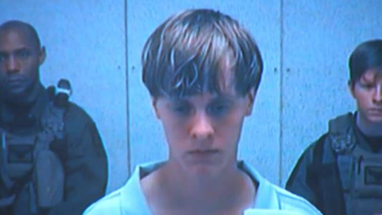 Dylann Roof looks down as he appears in court on the