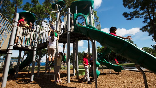 San Carlos Park Elementary fifth-graders play at school in a News-Press file photo. School operations continued as normal following an early morning fire on Sept. 20, 2019.