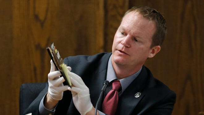 Texas Ranger Danny Briley identifies the Eddie Ray Routh's wallet during the capital murder trial of former Marine Cpl. Routh at the Erath County, Donald R. Jones Justice Center in Stephenville, Texas, Monday, Feb. 16, 2015. Routh, 27, of Lancaster, is charged with the 2013 deaths of former Navy SEAL Chris Kyle and his friend Chad Littlefield at a shooting range near Glen Rose, Texas.  (AP Photo/Star-Telegram, Rodger Mallison, Pool)