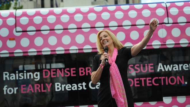 Reno City Councilmember Neoma Jardon celebrates the fact that she is done with her treatments during the unveiling of a wrapped RTC bus designed to raise awareness for dense breast tissue awareness and cancer detection on Virginia St. in downtown Reno on Sept. 24, 2015.