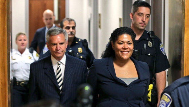 Judge Leticia Astacio of Rochester (N.Y.) City Court is escorted into an elevator in handcuffs June 5, 2017, after a meeting with her New York Supreme Court supervisor in the Monroe County Hall of Justice in Rochester.