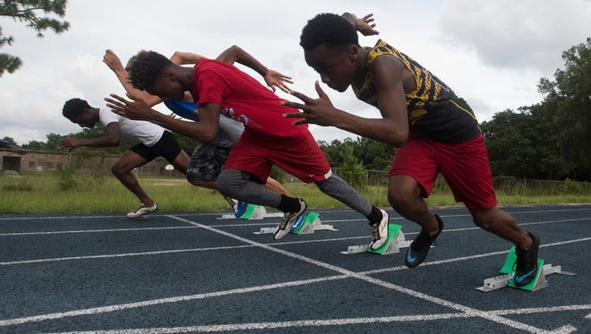 Golden Elite Track Club sprinters train at Washington High School Tuesday afternoon, July 11, 2017, for the upcoming AAU Junior Olympics meet in Detroit. The local track club is sending 36 athletes competition.