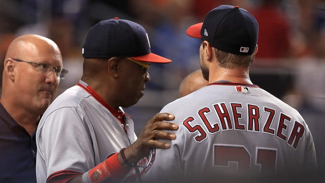 After hitting his first major league home run in the first inning, Max Scherzer left Tuesday's game in the top of the second inning with neck spasms.