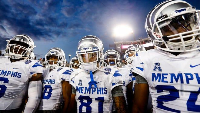 Memphis players prepare to take the field against Houston last season.