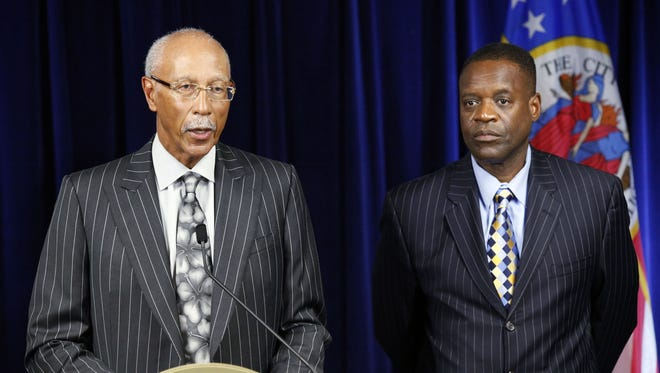 Detroit Mayor Dave Bing, left, speaks as state-appointed emergency manager Kevyn Orr listens during a news conference in Detroit in July 2013.