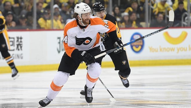 Sean Couturier skated on his own after Tuesday's injury in practice and hasn't ruled out playing in Friday's elimination game.