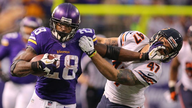 Adrian Peterson (28) of the Minnesota Vikings carries the ball against the Chicago Bears on Dec. 1, 2013, at Mall of America Field at the Hubert Humphrey Metrodome in Minneapolis.