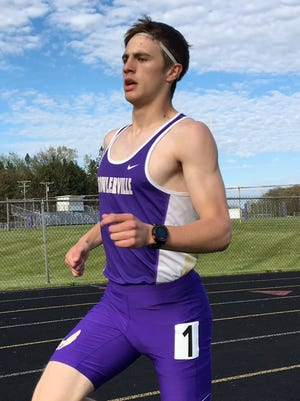 Fowlerville junior Chris Davis races the 1,600-meter run in a dual meet against Williamston on May 9, 2017.