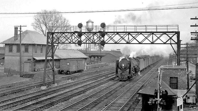 Westbound steam engine passing the Penfield Station, circa 1950. Washington Street crossing is in the foreground.