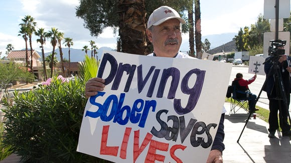 """The public along with family, friends and co-workers of Celena Nava, who was killed last month after she and a friend were hit by a suspected drunk driver, attend """"Silent Stand Along Highway 111""""  held at Highway 111 & Bob Hope Drive in Rancho Mirage on Saturday morning, December 7, 2013."""