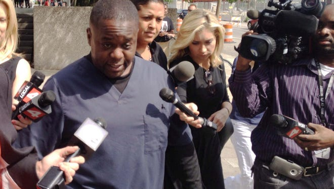 Charles Bothuell IV leaves the Frank Murphy Hall of Justice in Detroit, Mich. on June 27, 2014, after a court hearing for his wife, Monique Dillard-Bothuell.