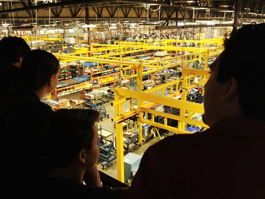 Students from several high schools and a middle school view the assembly area at Haas Automation in Oxnard in Thursday.