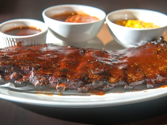 A full rack of St. Louis style bbq ribs with spicy