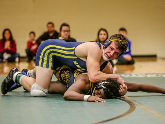 Andrew Spisz and the Hartland wrestling team could