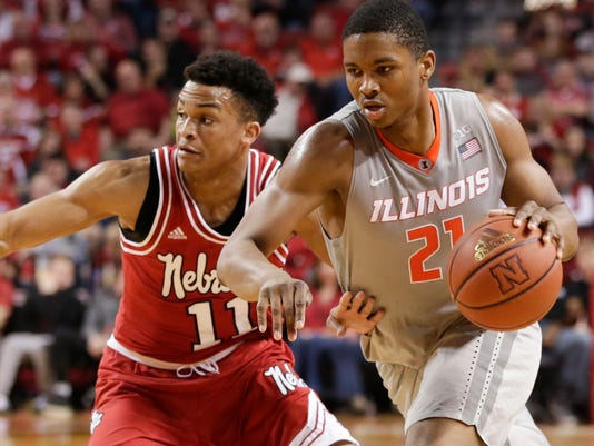 Illinois' Malcolm Hill (21) tries to get around Nebraska's Evan Taylor (11) during the second half of an NCAA college basketball game in Lincoln, Neb., Sunday, Feb. 26, 2017. Illinois won 73-57. (AP Photo/Nati Harnik)