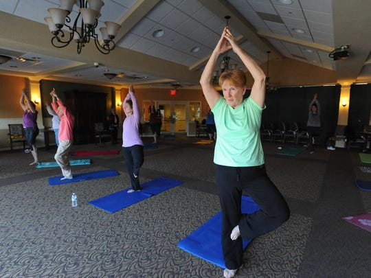 Wilma Reichl, right of Smyrna in Mabes Morrill's yoga class at Westminster Village in Dover. Mabes, age 93, started yoga because she had arthritis.
