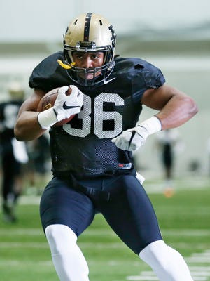 Richie Worship during a running drill at Purdue spring football practice Thursday, April 7, 2016, inside the Mollenkopf Athletic Center.