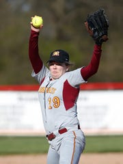 McCutcheon's Bear Wood with the delivery against Harrison Tuesday, April 12, 2016, at McCutcheon High School. Harrison defeated McCutcheon 5-1.