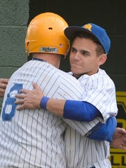 Northern Lebanon's Hayden Johnson hugs Chase Dubendorf (6) after he knocked in a run during a 10-inning loss to Lebanon late in the regular season.
