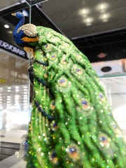 A $17,000 Swarovski Crystal peacock for sale in David Sweet's Revival Collectibles Tuesday, Nov. 29, 2016 in Grand Ledge. Sweet turned a passion of collecting into a brick-and-mortar operation. His shop buys and sells jewelry, Swarovski items, antiques and more.
