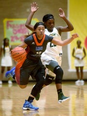 Southwood's Danesha Hall brings the ball up the court