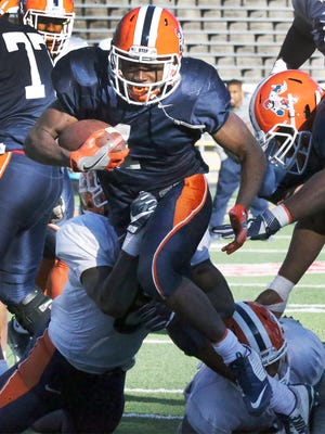 UTEP running back Quadraiz Wadley, 4, scurries downfield for a touchdown during scrimmage last spring in Sun Bowl Stadium.