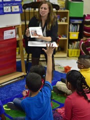 Kelly Pallavaram teaches a GrapeSEED Program class, designed to fast-forward English language skills of students, at Stevens Elementary School on Tuesday, November 14, 2016.