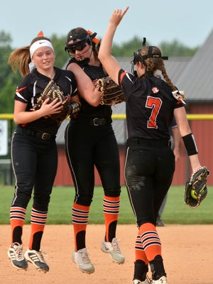 Central York shortstop Erin Cabry (left) and second baseman Lorna Colberg (center) celebrate with pitcher Courtney Coppersmith after an out during the York-Adams softball championship at New Oxford High School, Wednesday, May 17, 2017.  The Panthers enter the District 3 6-A tournament as the No. 2 seed and with a first round bye, but still need to win a agme to justify all of this season's accomplishments. John A. Pavoncello photo