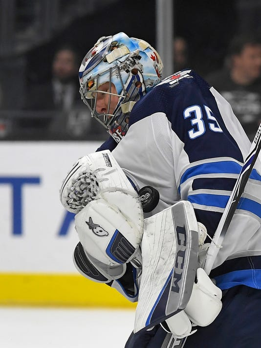 Winnipeg Jets goalie Steve Mason stops a shot during the second period of an NHL hockey game against the Los Angeles Kings, Wednesday, Nov. 22, 2017, in Los Angeles. (AP Photo/Mark J. Terrill)