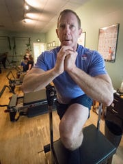 Southwest Airlines pilot is Brian Larson works out at the Pilates Center of York inside Strictly Fitness in Springettsbury Township. Larson found himself sitting for long periods of time while flying and was starting to have trouble walking.