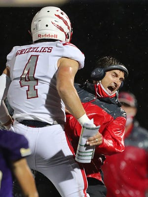 Wadsworth football coach Justin Todd celebrates a touchdown with receiver Barrett Labus during the first quarter of a week one football game against North Royalton at Serpentini Chevrolet Stadium, Friday, Aug. 28, 2020, in North Royalton, Ohio.